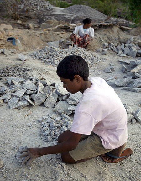 A boy and his mother break pieces of granite in a quarry in the remote village of Thumbalai, 300km (186 miles) east of Colombo.