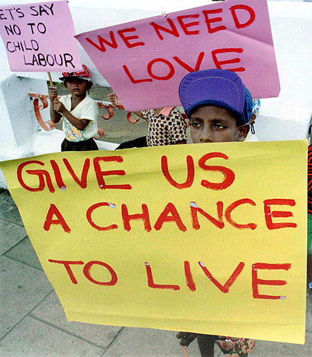 Street children protest against sexual abuse and the use children as domestic workers during a demonstration in Colombo.