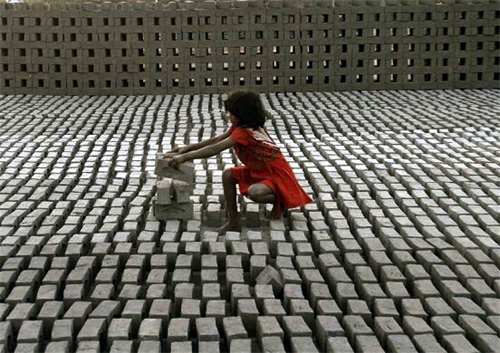 A child-labourer works inside a brick factory on the outskirts of Hyderabad.