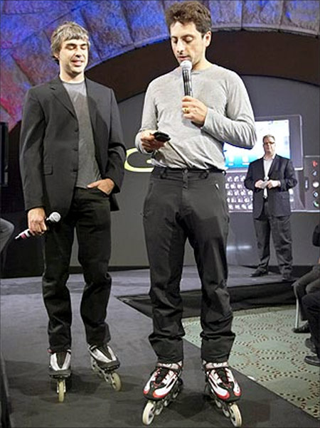 Larry Page (left) and Sergey Brin, founders of Google, show the new G1 phone running Google's Android software.