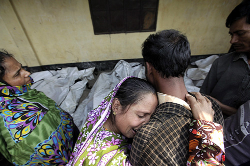 Relatives mourn the death of a garment worker after a fire occurred in a garment factory in Savar.