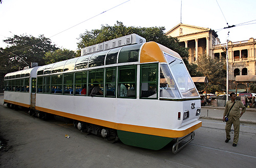 A conductor stands beside a new tram in the eastern Indian city of Kolkata.