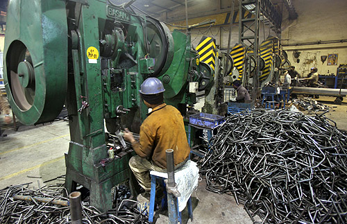 Men work inside a steel factory at Ludhiana in the northern Indian state of Punjab.