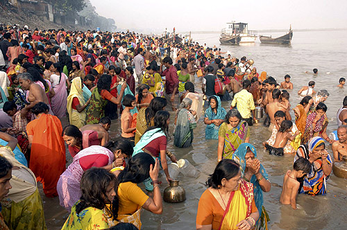 Devotees take a dip in the holy Ganges river during celebrations for the Chhat Puja festival.