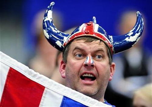 An Iceland fan shouts during their men's European Handball Championship group B match against Serbia in Linz.