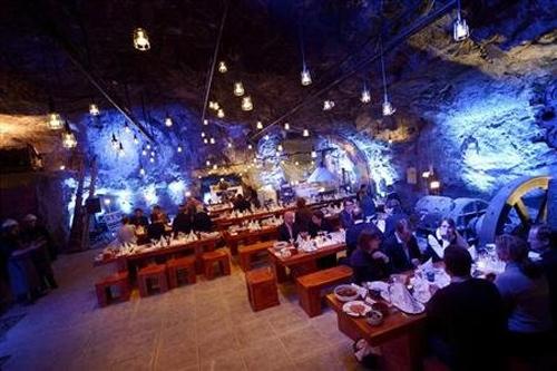 Customers eat their dinner at Muru Pop Down restaurant at Tytyri mine in Lohja.