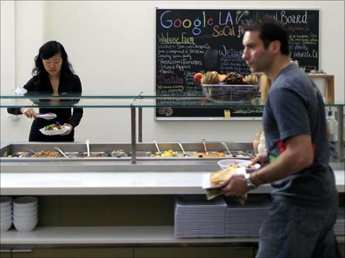 People eat in the cafeteria at the Google campus near Venice Beach, in Los Angeles.