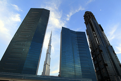 The Burj Khalifa (C) is seen, framed by towers and buildings under construction on Sheikh Zayed road in Dubai.
