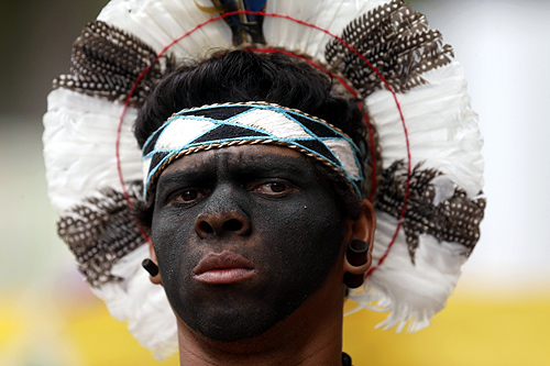 An indigenous man protests before the visit of FIFA Secretary General Jerome Valcke at Maracana Stadium in Rio de Janeiro.