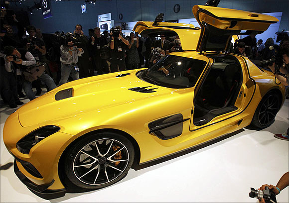Photographers take pictures of the 2013 Mercedes-Benz SLS AMG gull wing car at the 2012 Los Angeles Auto Show in Los Angeles, California.