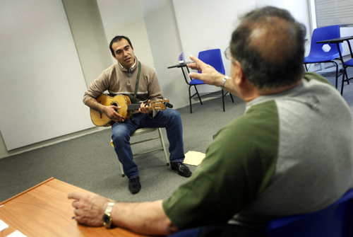 An applicant plays the vihuela in front of a teacher during a selection process for entry into the school of Maricahi Ollin Yoliztli in Mexico City.