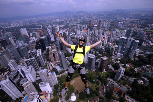 BASE jumper Eder Navacerrada of Spain leaps before opening his parachute, from Kuala Lumpur Tower.