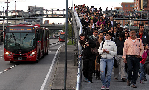 Passengers descend from a transmilenio station in a central avenue in Bogota.