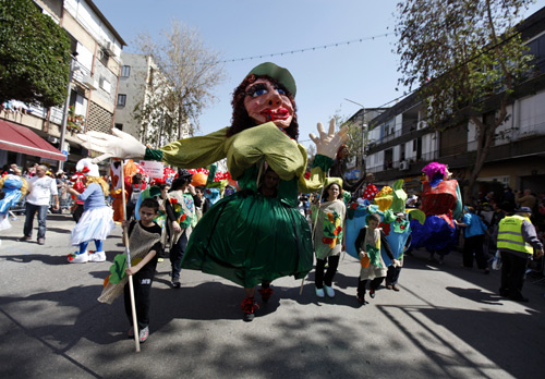 Israeli dressed in costumes take part in an annual parade for the Jewish holiday of Purim in the Israeli city of Holon, near Tel Aviv.