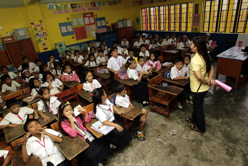 A teacher gives lessons to second grade pupils during classes in a public elementary school in Quezon city, Metro, Manila.