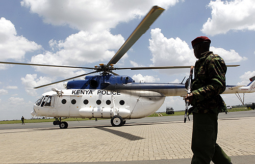 A Kenyan policeman guards a helicopter transporting seized heroin from the port city of Mombasa at Wilson airport in the capital Nairobi.
