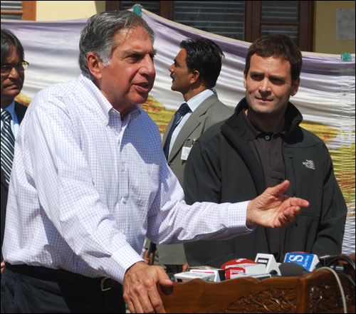 Ratan Tata addresses a gathering; on his right, Rahul Gandhi, the Congress general secretary