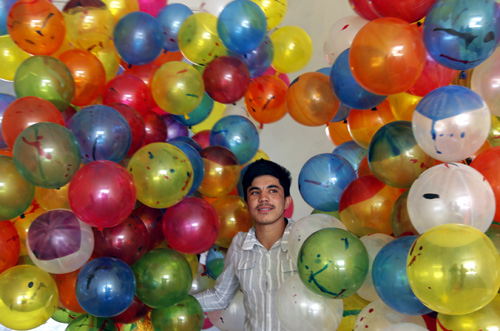 An Afghan man holds balloons for sale near the National Stadium in Kabul.