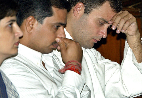 Rahul Gandhi (R) flanked by his brother-in-law Robert Vadra (C) and sister Priyanka Vadra.