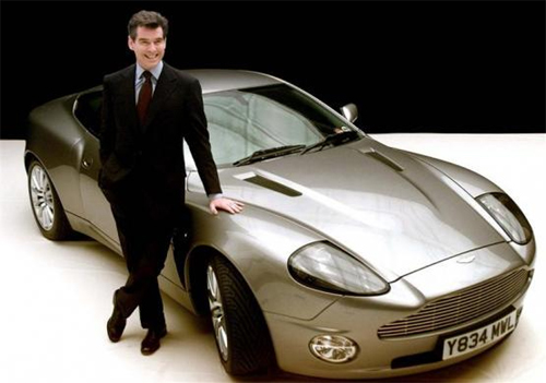 James Bond actor Pierce Brosnan poses for photographers with the Bond car, an Aston Martin V12 Vanquish, at Pinewood Studios in London.
