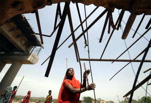 A woman labourer works at a road construction site on the outskirts of Hyderabad.