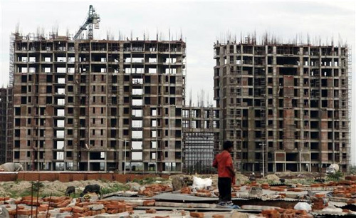 Labourers work at the construction site of a residential complex on the outskirts of New Delhi.