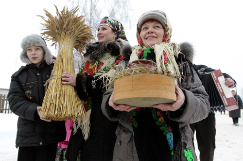 People take part in Kolyada holiday celebrations in Noviny, some 90 km (56 miles) east of the capital Minsk.