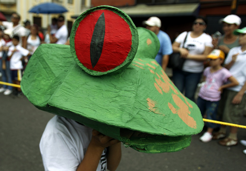A student wears a frog mask during Costa Rica's Independence Day celebrations in San Jose.