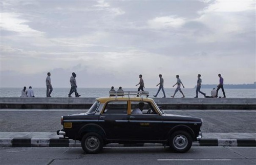 A driver waits for customers in his Premier Padmini taxi on Marine Drive in Mumbai.