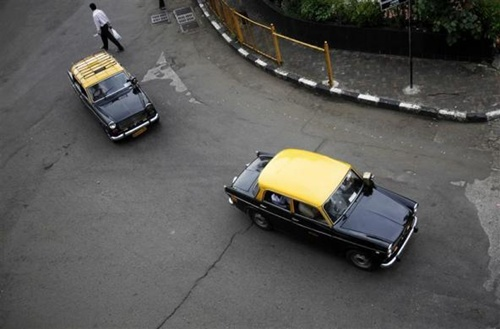 Sunset for Mumbai's famous black and yellow taxis