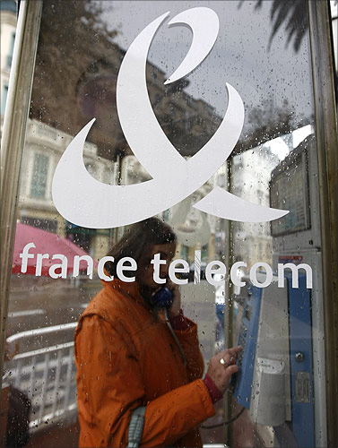 A woman makes a phone call in a France Telecom phone box in Nice, southern France.