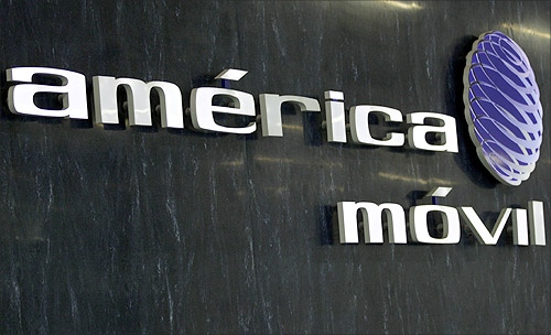 The logo of America Movil is seen on the wall of the reception area in the company's new corporate offices in Mexico City.