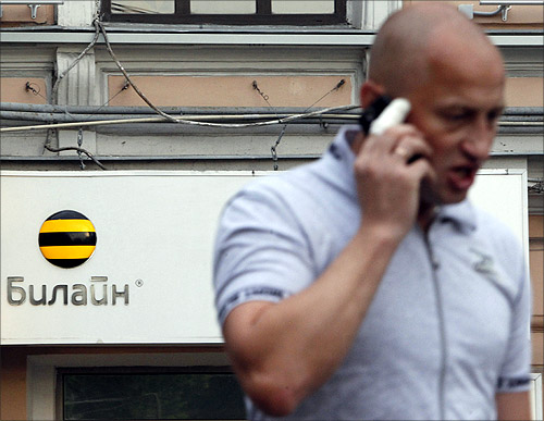 A man speaks on the phone near an office of Beeline, the brand owned by mobile phone operator Vimpelcom, in Moscow.