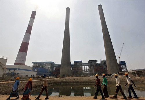 Workers walk inside the Jindal Power and Steel Ltd. complex at Nisha village in Orissa.