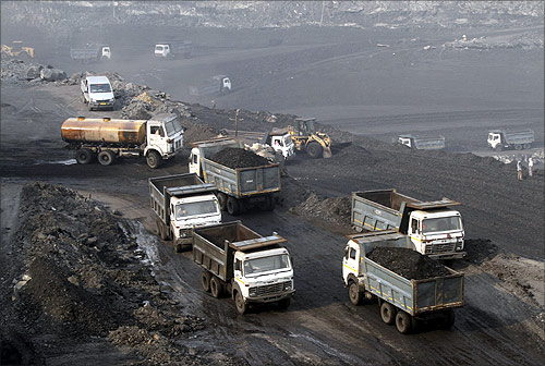 Trucks move in the Mahanadi coal fields, near Talcher town in Orissa.