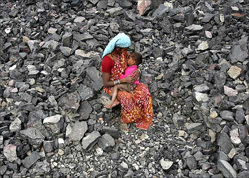 A worker at a coal yard in Jammu.
