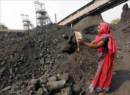 A labourer works at the Mahanadi coal fields at Dera, near Talcher town in Orissa.