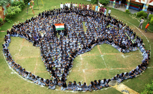 School girls form a shape of India as they pray for world peace at Jodhpur in Rajasthan.
