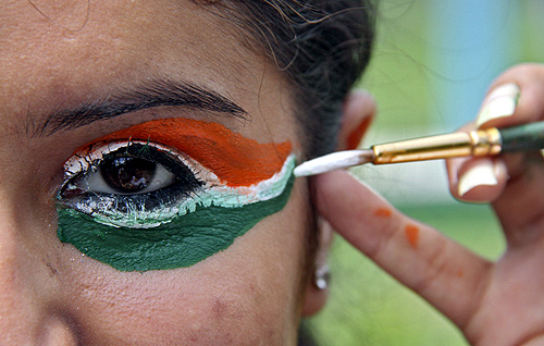 A college girl gets her eye painted in tri-colours of India's national flag on the eve of the country's Independence Day celebrations in the northern Indian city of Chandigarh.