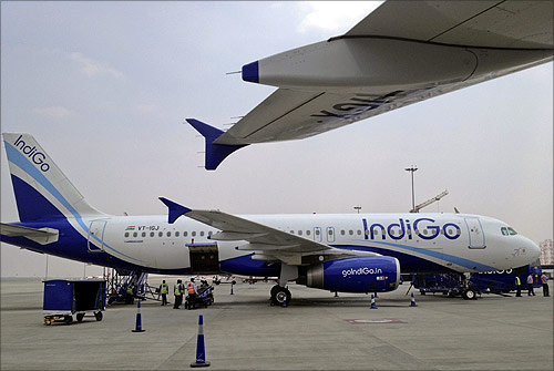 An IndiGo Airlines A320 aircraft is parked on the tarmac at Bengaluru International Airport.