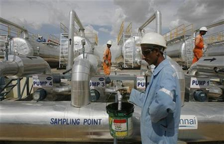 Cairn India employees work at a storage facility for crude oil at Mangala oil field at Barmer in Rajasthan.