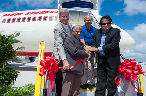 Jack Jones, VP and GM Boeing South Carolina, Air India Capt. A. S. Soman, Dinesh Keskar, Sr VP of Asia Pacific and India Sales for Boeing Commercial Airplanes, and M. L. Franklin, Air India technical team leader cutting the ceremonial ribbon.