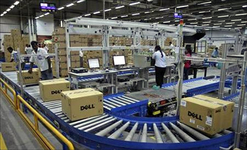 Computers packed into boxes are transported on a conveyor belt at a Dell factory in Sriperumbudur Taluk, in the Kancheepuram district of Tamil Nadu.