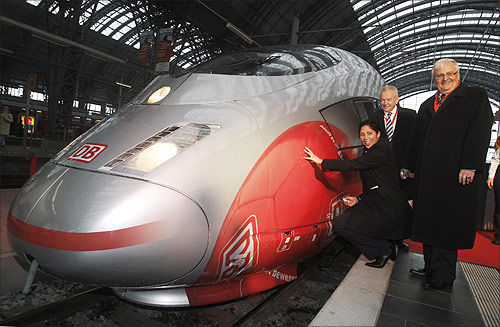 Rail operator Deutsche Bahn CEO Ruediger Grube (C) poses with Steffi Jones (L), head of the organization committee of the Women's Soccer World Cup and Theo Zwanziger (R) president of the German Football Association (DFB) in front of a ICE high speed train with the design of the Women's Soccer World Cup 2011, in Frankfurt.