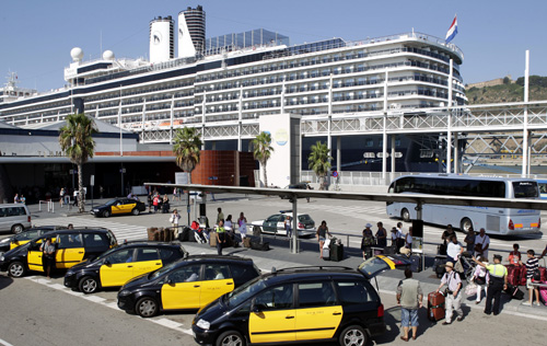 People wait in a taxi stand at a Barcelona's cruise terminal.