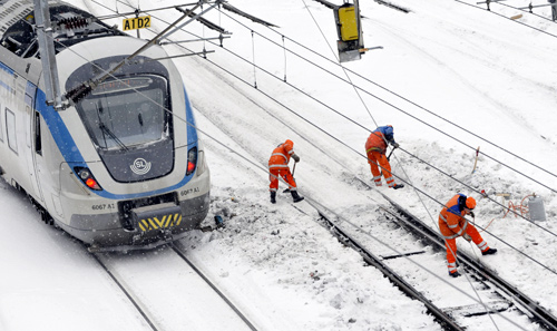 Railway workers tries to clear points from ice and snow at the marshalling yard at the Central Station in Stockholm.