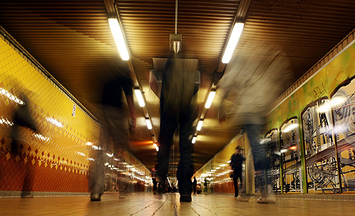 People walk inside a tunnel at Central train station in Sydney.