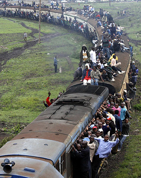 Passengers ride atop overloaded carriages of a commuter train in Kenya's capital Nairobi.