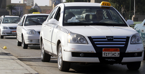 New white taxis are seen on a road in downtown Cairo.