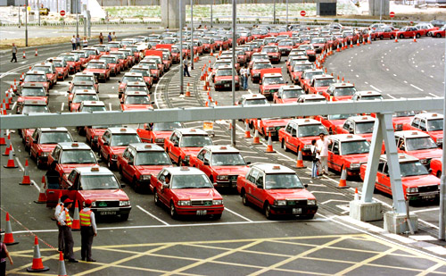 Hundreds of taxis wait for customers at Hong Kong's new international airport.
